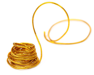 Golden rope over white background