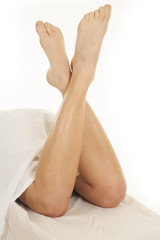 Legs crossed up under sheets