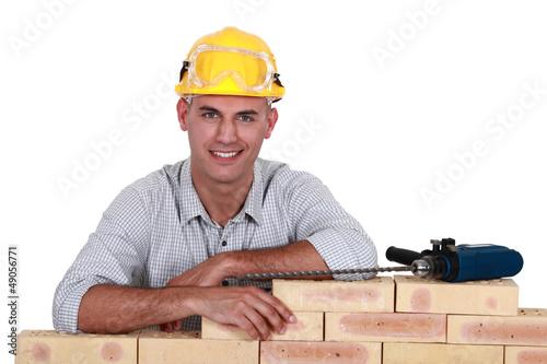 Smiling mason, studio shot