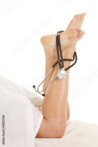 Woman legs sheet doctor