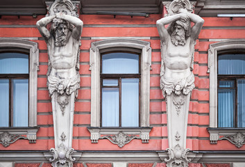Facade with men statues. Old palace in St.Petersburg, Russia