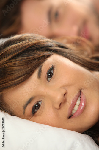 Mixed-race couple in bed