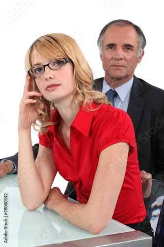 Businessman sat with young intern