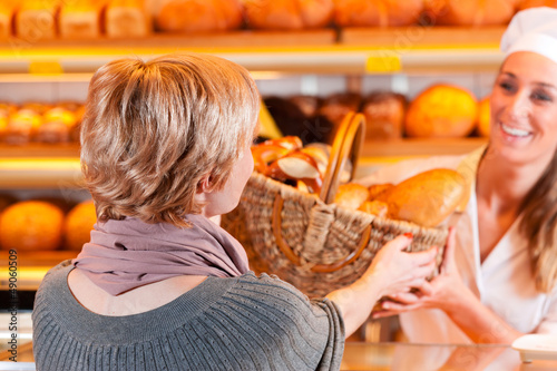 Salesperson with female customer in bakery