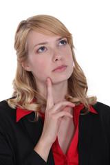 A pensive cute businesswoman.
