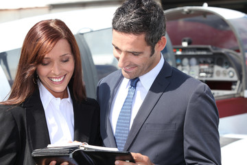 Smiling businesspeople reading notes