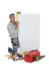 craftsman taking measurements