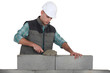 Bricklayer laying blocks