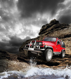 Fototapety Offroad vehicle on the mountain terrain