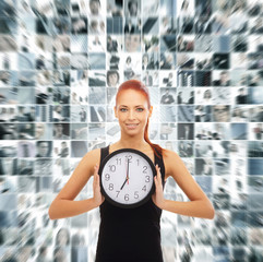 A redhead woman holding a clock on a business background