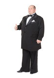 Elegant fat man in a tuxedo shows thumb-up