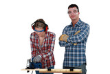 Couple using circular saw