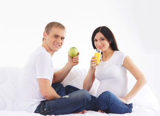 A young couple with fresh food preparing for the baby