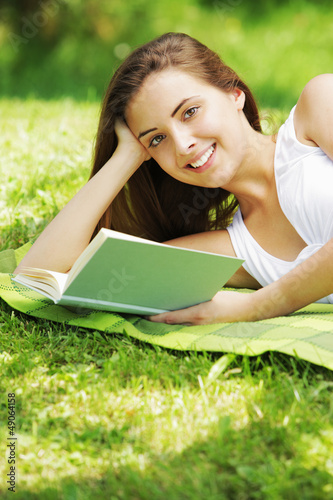 Smiling woman reading book