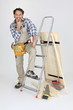 portrait of cabinetmaker posing near ladder