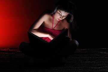 Light of book - the girl seriously reading