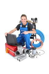 Female plumber with equipment, studio shot
