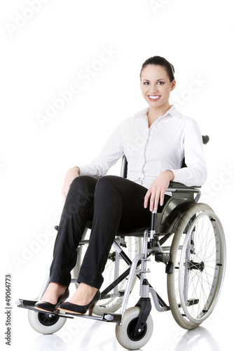 Attractive disabled businesswoman sitting in a wheel chair