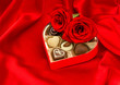 red roses and delicious chocolate pralines