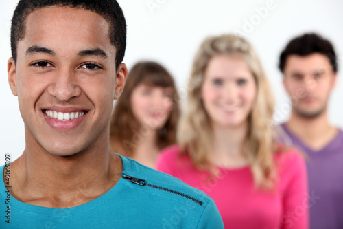 Four friends stood on white background