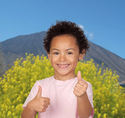 Happy latin child saying Ok with a volcano
