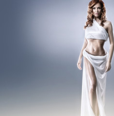Aphrodite styled young woman over grey background