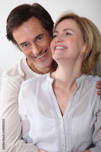 Man holding partner in arms