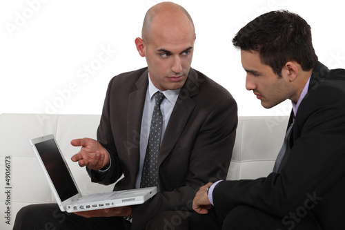 Serious businessmen with a laptop