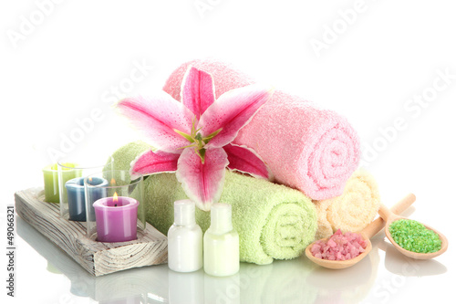 towels with lily, aroma oil,  candles and sea salt isolated