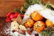 christmas composition with oranges and fir tree in Santa Claus