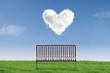 Empty chair under heart clouds