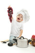little girl in chef's hat with kitchen accessories ang grape,