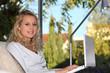 Teenage girl using a laptop computer