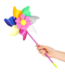 Colored pinwheel in hand isolated on white