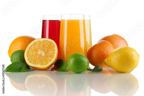 Glasses of juise with leafs and fruits isolated on white
