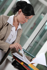 serious businesswoman reading documents