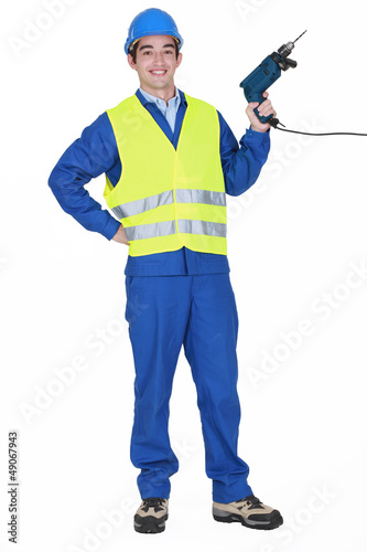Cheerful builder holding drill