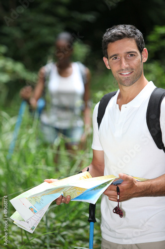 Couple  hiking with a map