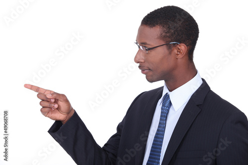 Profile shot of a man in a suit pointing his finger