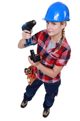 craftswoman putting a charger in a drill