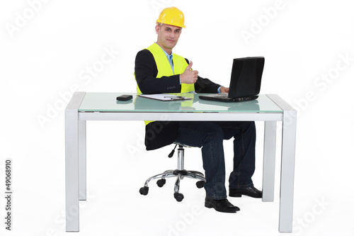 Architect sitting with computer