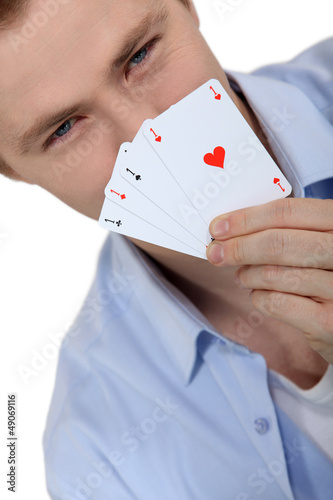 Young man holding up cards