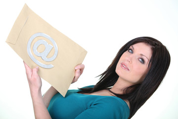 Woman holding an envelope with an at sign on it