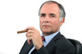 Businessman smoking cigar