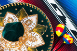 Multi colored mexican poncho, traditional sombrero and maracas