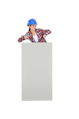 Female builder stood with poster