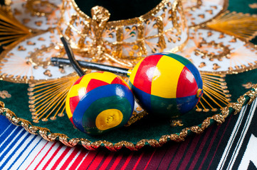 Mexican sombrero and maracas, close-up, studio shot
