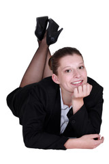 Relaxed businesswoman lying on the floor