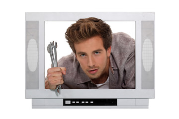 Concept shot of a television repairman