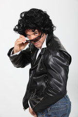 Man wearing leather jacket, sunglasses and wig